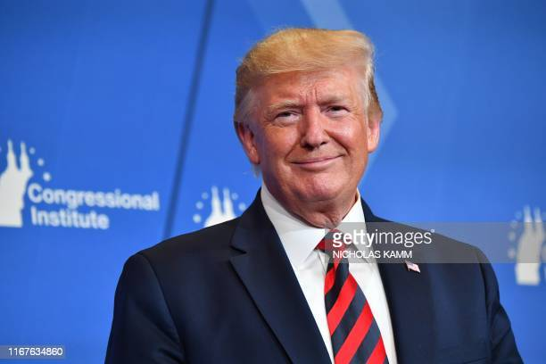 US President Donald Trump smiles as he delivers remarks during the 2019 House Republican Conference Member Retreat Dinner in Baltimore Maryland on...