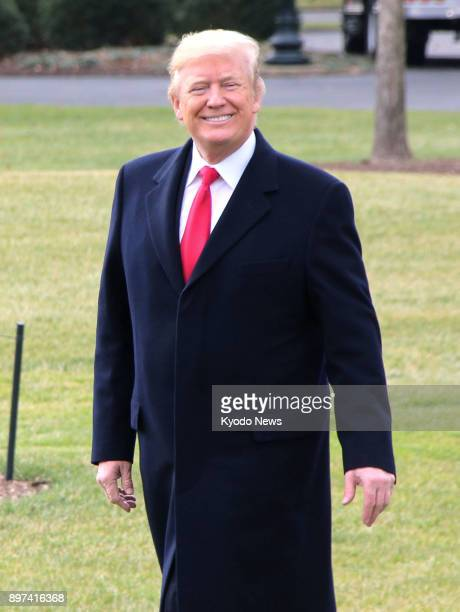 US President Donald Trump smiles as he leaves the White House in Washington on Dec 22 the same day he signed a $15 trillion tax bill into law the...
