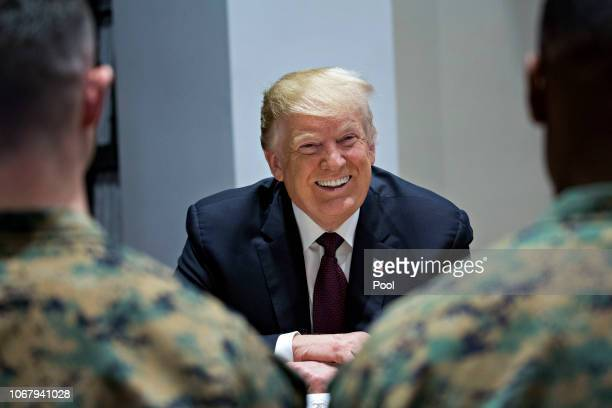 S President Donald Trump smiles as he meets with Marines while visiting Marine Barracks on November 15 2018 in Washington DC President Trump and the...