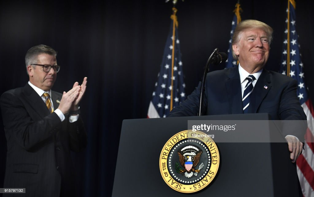 U.S. President Donald Trump smiles as Representative Randy Hultgren, a Republican for Illinois, left, applauds during the National Prayer Breakfast in Washington, D.C., U.S., on Thursday, Feb. 8, 2018. Trump urged a more just and peaceful world, praised the military and U.S. advances in fighting Islamic State and reiterates support for oppressed people in Iran and North Korea. Photographer: Mike Theiler/Pool via Bloomberg