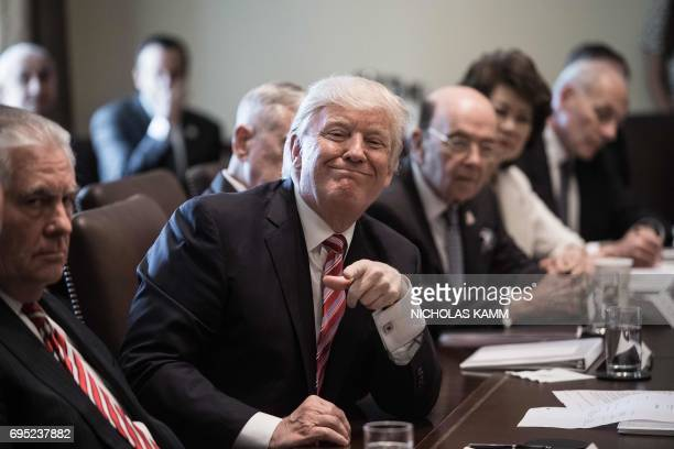 US President Donald Trump smiles during a cabinet meeting at the White House in Washington DC on June 12 2017 / AFP PHOTO / NICHOLAS KAMM