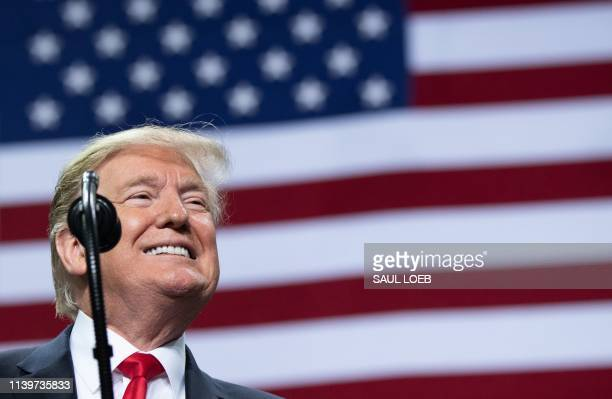US President Donald Trump smiles during a Make America Great Again rally in Green Bay Wisconsin April 27 2019