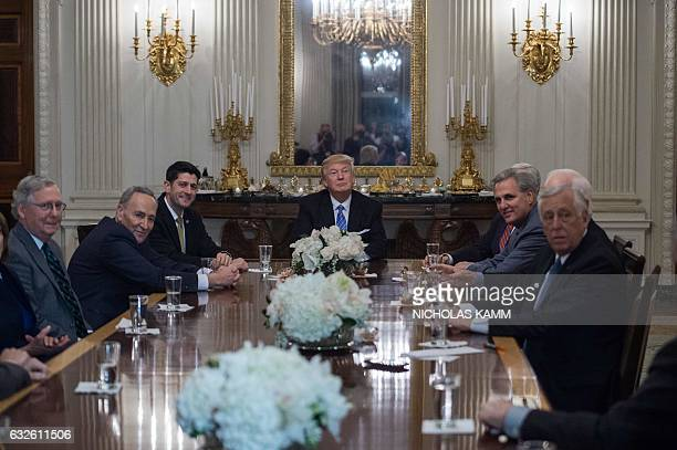 US President Donald Trump smiles during a reception with Congressional leaders including Senate Majority Leader Mitch McConnell Senate Minority...