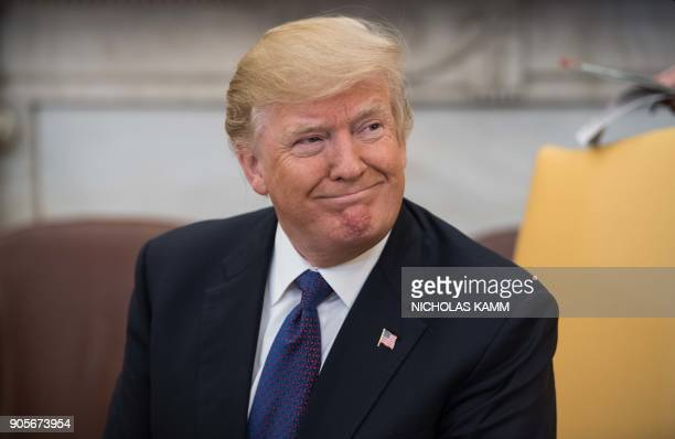 US President Donald Trump smiles during his meeting with his Kazakh counterpart Nursultan Nazarbayev in the Oval office at the White House in...