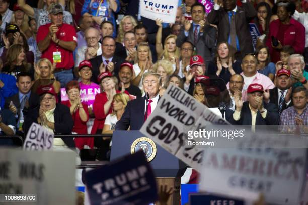 US President Donald Trump smiles onstage during a rally in Tampa Florida US on Tuesday July 31 2018 Iranian Foreign Minister Javad Zarif pushed back...