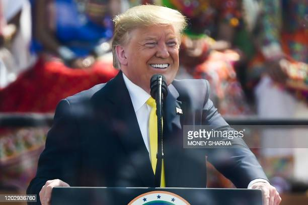 US President Donald Trump smiles while addressing 'Namaste Trump' rally at Sardar Patel Stadium in Motera on the outskirts of Ahmedabad on February...