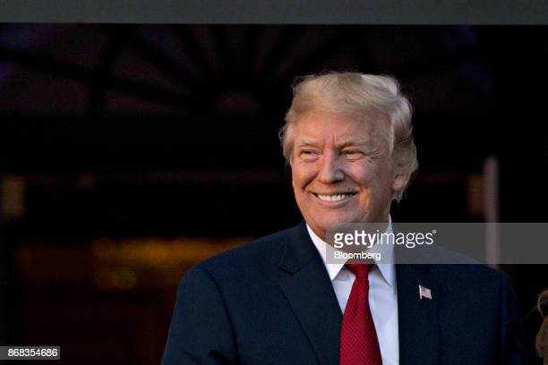 US President Donald Trump smiles while hosting a Halloween event on the South Lawn of the White House in Washington DC US on Monday Oct 30 2017 Trump...