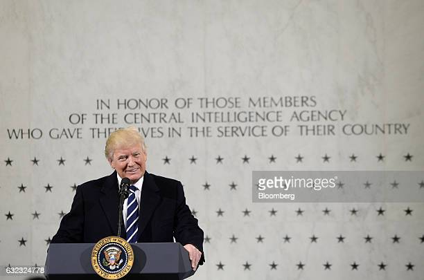 US President Donald Trump smiles while speaking at the CIA Headquarters in Langley Virginia US on Saturday Jan 21 2017 Trump assured employees at the...