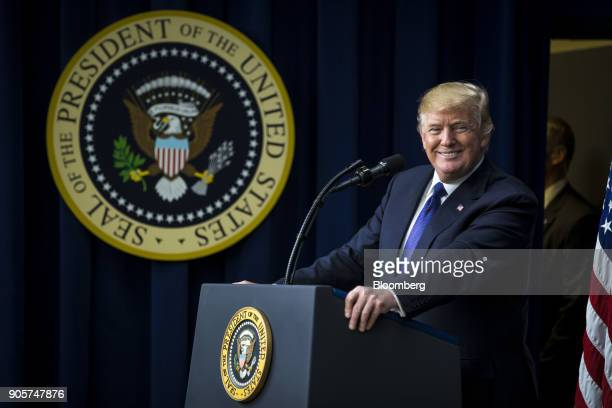 US President Donald Trump smiles while speaking during a 'Conversations with the Women of America' event at the Eisenhower Executive Office Building...