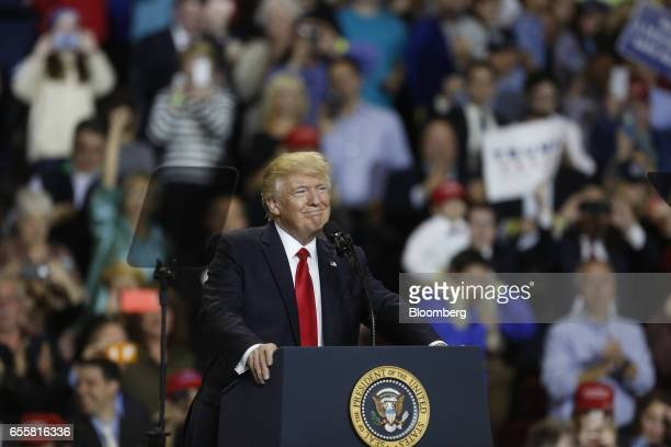 US President Donald Trump smiles while speaking during a rally at the Kentucky Exposition Center in Louisville Kentucky US on Monday March 20 2017...