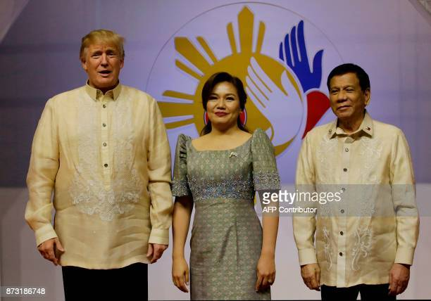 US President Donald Trump smiles with Philippine President Rodrigo Duterte and his partner Cielito Avanceno before the Special Gala Celebration of...