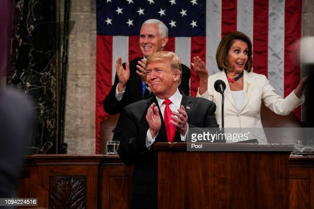 S President Donald Trump Speaker Nancy Pelosi and Vice President Mike Pence applaud during the State of the Union address in the chamber of the US...