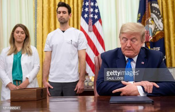 US President Donald Trump speaks about COVID19 known as coronavirus alongside nurses after signing a Proclamation in honor of National Nurses Day in...