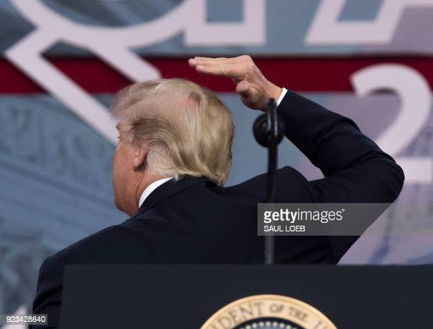 US President Donald Trump speaks about his hair during the 2018 Conservative Political Action Conference at National Harbor in Oxon Hill Maryland...
