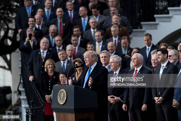 President Donald Trump speaks about newly passed tax reform legislation during an event December 20 2017 at the White House in Washington DC Trump...