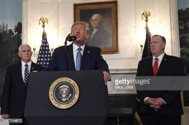 US President Donald Trump speaks about Syria in the Diplomatic Reception Room at the White House in Washington DC October 23 2019 as US Vice...