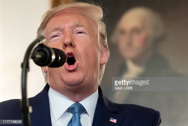 US President Donald Trump speaks about Syria in the Diplomatic Reception Room at the White House in Washington DC October 23 2019 President Donald...