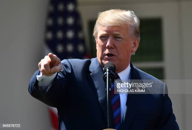 US President Donald Trump speaks about tax cuts for Americans from the Rose Garden at the White House on April 12 2018 in WashingtonDC / AFP PHOTO /...