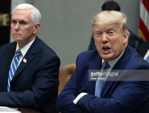 S President Donald Trump speaks about the Coronavirus response while flanked by Vice President Mike Pence during a coronavirus briefing with health...