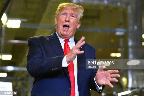 US President Donald Trump speaks about the impeachment inquiry during a tour of the Flextronics computer manufacturing facility where Apple's Mac...