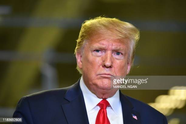 President Donald Trump speaks about the impeachment inquiry during a tour of the Flextronics computer manufacturing facility where Apple's Mac Pros...