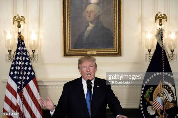 President Donald Trump speaks about the Iran deal from the Diplomatic Reception room of the White House in Washington DC on October 13 2017 Trump...