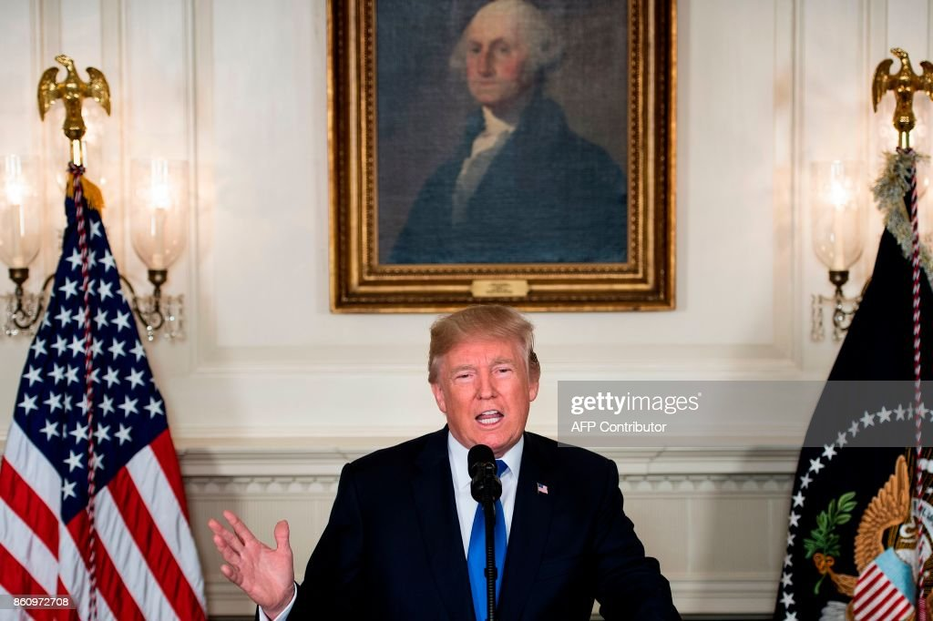 US President Donald Trump speaks about the Iran deal from the Diplomatic Reception room of the White House in Washington, DC, on October 13, 2017. Trump announced he will not certify the Iran nuclear deal and warned that the US could leave the Iran deal 'at any time.' / AFP PHOTO / Brendan Smialowski