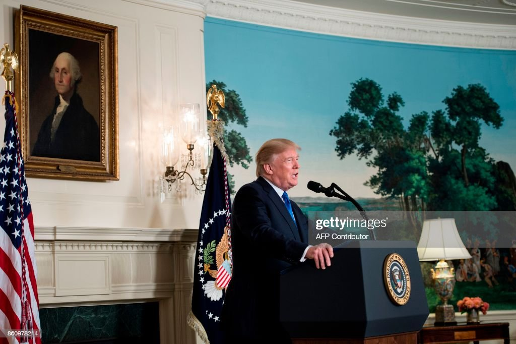 US President Donald Trump speaks about the Iran deal from the Diplomatic Reception room of the White House in Washington, DC, on October 13, 2017. President Donald Trump on October 13 refused to certify the 2015 Iranian nuclear deal, and warned the United States may yet walk away from 'one of the worst' agreements in history. / AFP PHOTO / Brendan Smialowski