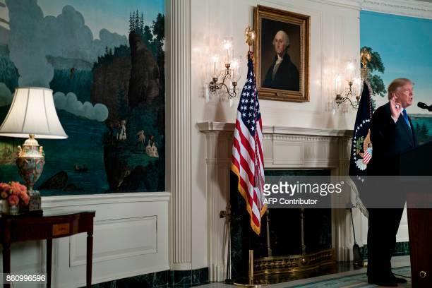 US President Donald Trump speaks about the Iran deal from the Diplomatic Reception room of the White House in Washington DC on October 13 2017 Trump...