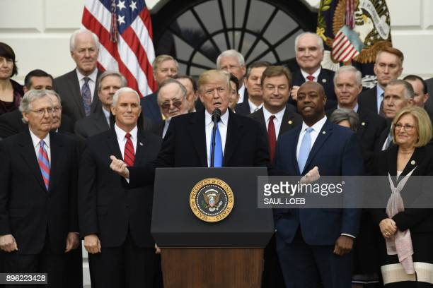 US President Donald Trump speaks about the passage of tax reform legislation on the South Lawn of the White House in Washington DC December 20 2017...