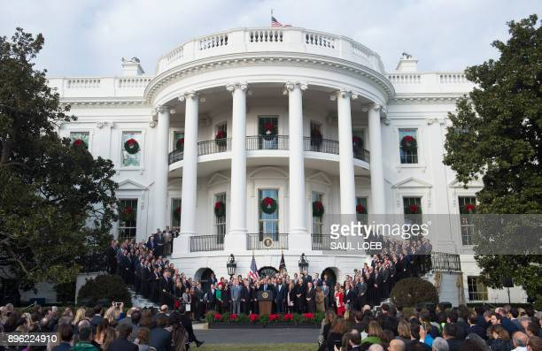 President Donald Trump speaks about the passage of tax reform legislation on the South Lawn of the White House in Washington DC December 20 2017...