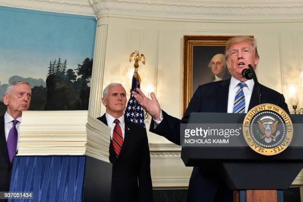 US President Donald Trump speaks about the spending bill during a press conference in the Diplomatic Reception Room at the White House on March 23...