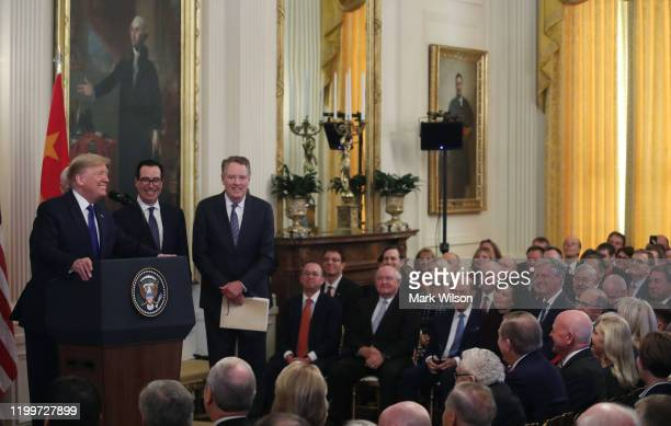 S President Donald Trump speaks accompanied by Treasury Secretary Steve Mnuchin and US Trade Representative Robert Lighthizer before he and Chinese...