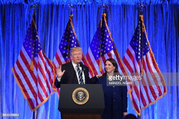 US President Donald Trump speaks after his introduction by RNC Chairwoman Ronna Romney McDaniel at a fundraising breakfast in a restaurant in New...