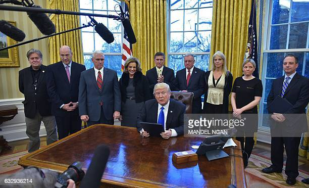 US President Donald Trump speaks after signing an executive memorandum on defeating the Islamic State in Iraq and Syria in the Oval Office of the...