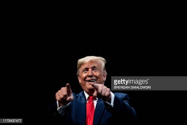 US President Donald Trump speaks after signing an executive order regarding Medicare at Sharon L Morse Performing Arts Center October 3 in The...