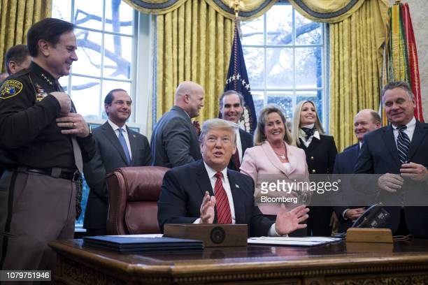 US President Donald Trump speaks after signing antihuman trafficking legislation in the Oval Office at the White House in Washington DC US on...