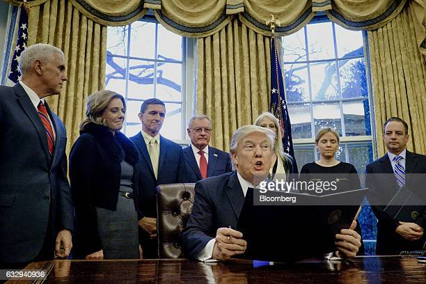US President Donald Trump speaks after signing executive orders related to a lobbying ban in the Oval Office of the White House in Washington DC US...