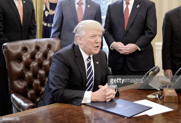 US President Donald Trump speaks after signing HJ Res 41 in the Oval Office of the White House on February 14 2017 in Washington DC The resolution...