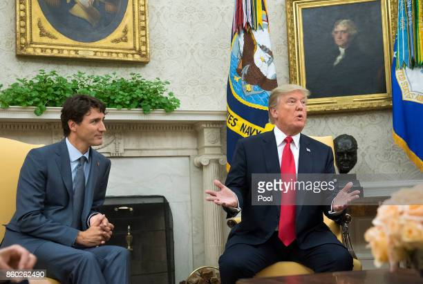 US President Donald Trump speaks alongside Canadian Prime Minister Justin Trudeau during a meeting in the Oval Office at the White House on October...