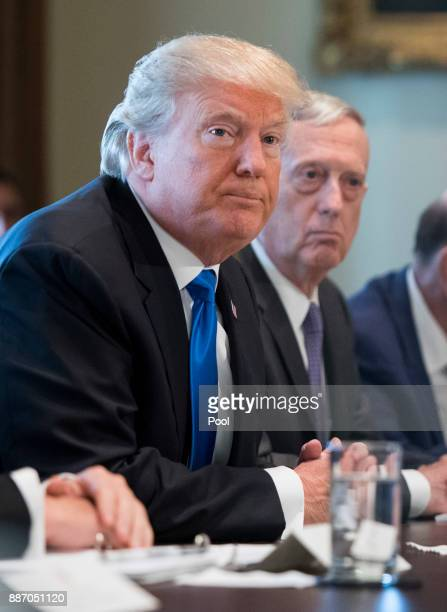 President Donald Trump speaks alongside Defense Secretary Jim Mattis as he addresses the press during a Cabinet meeting at the White House on...