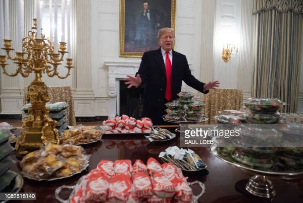 President Donald Trump speaks alongside fast food he purchased for a ceremony honoring the 2018 College Football Playoff National Champion Clemson...