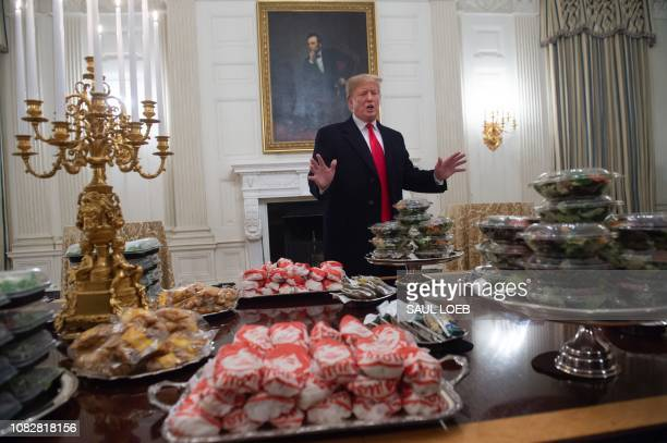 US President Donald Trump speaks alongside fast food he purchased for a ceremony honoring the 2018 College Football Playoff National Champion Clemson...