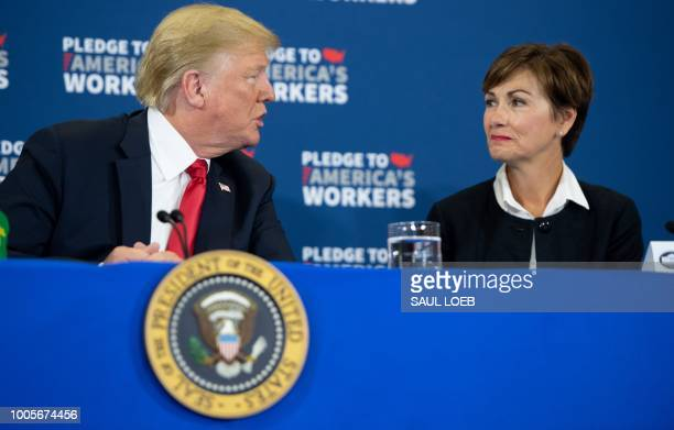 US President Donald Trump speaks alongside Iowa Governor Kim Reynolds as he holds a roundtable discussion on workforce development at Northeast Iowa...