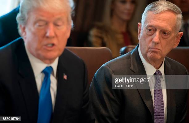 US President Donald Trump speaks alongside Secretary of Defense Jim Mattis as he holds a Cabinet Meeting in the Cabinet Room at the White House in...