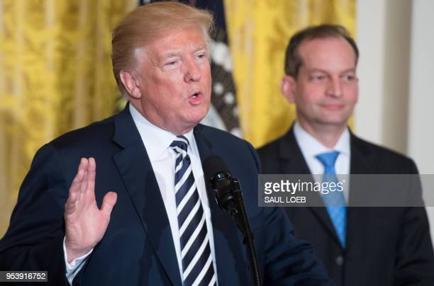 US President Donald Trump speaks alongside Secretary of Labor Alexander Acosta during the National Teacher of the Year reception in the East Room of...