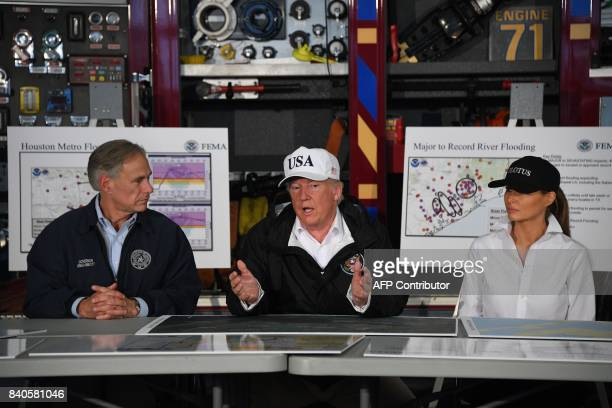 US President Donald Trump speaks alongside Texas Governor Greg Abbott and First Lady Melania Trump during a firehouse briefing on Hurricane Harvey in...