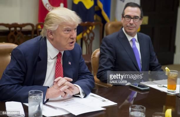 US President Donald Trump speaks alongside Treasury Secretary Steven Mnuchin during a meeting about the federal budget in the Roosevelt Room at the...