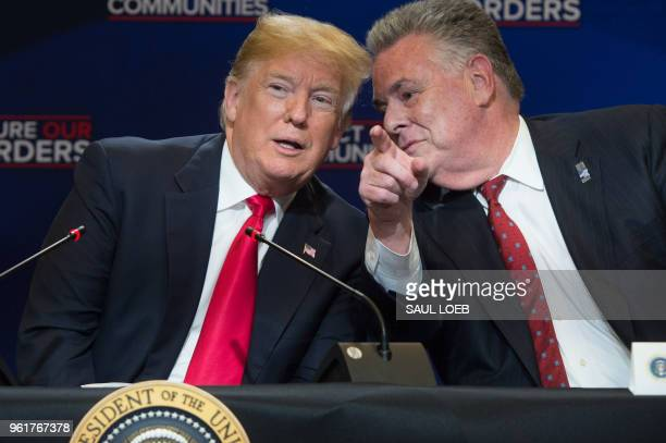 US President Donald Trump speaks alongside US Representative Peter King Republican of New York during a roundtable discussion on immigration at...