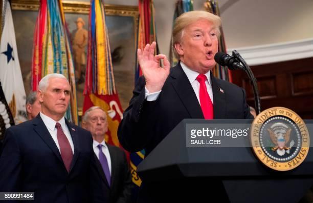US President Donald Trump speaks alongside US Vice President Mike Pence and Secretary of Defense Jim Mattis prior to signing HR 2810 National Defense...